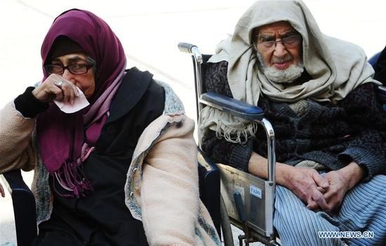An evacuated couple sit in a temporary shelter in Wafidin area, northeast of Damascus, capital of Syria, on March 13, 2018. A total of 146 civilians on Tuesday left the rebel-held areas in Syrian capital Damascus' Eastern Ghouta countryside. (Xinhua/Ammar Safarjalani)
