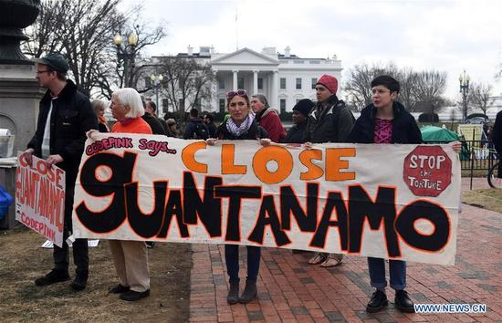 "Protesters rally to demand the closing of the Guantanamo Bay detention camp outside the White House in Washington D.C., the United States, on Jan. 11, 2018. Dozens of Activists held a rally here on Thursday to protest against the Guantanamo Bay detention camp while urging an end to ""indefinite detention."" (Xinhua/Yin Bogu)"