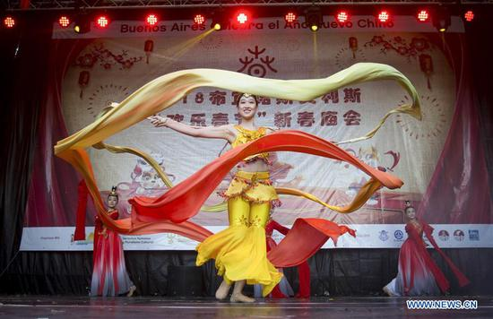 Artists from Hangzhou perform during the celebration of the Chinese Lunar New Year, in Buenos Aires, Argentina on Feb. 10, 2018. Argentinean citizens and Chinese residents in Buenos Aires gathered on Saturday in the Parques Nacionales Square to celebrate the Spring Festival and enjoy a show of traditional dance, music and acrobatics to welcome the Chinese New Year. (Xinhua/Martin Zabala)