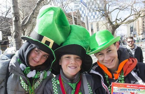 Dressed-up teenagers pose for photos during the 2018 Toronto St. Patrick's Day Parade in Toronto, Canada, March 11, 2018. Thousands of people came out to celebrate the Irish history, culture and heritage by taking part in the 2018 Toronto St. Patrick's Day Parade on Sunday. (Xinhua/Zou Zheng)