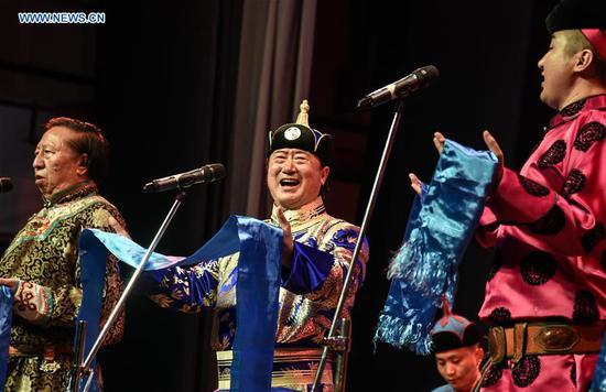 Musicians perform at the China silk road music concert during the