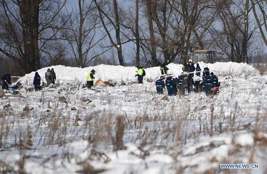 Image provided by Russian Emergencies Ministry on Feb. 12, 2018 shows Russian Emergencies Ministry officers working at the scene where the AN-148 passenger jet crashed on Feb. 11 in the Moscow region of Russia. Rescuers have presumably recovered the second flight data recorder of the AN-148 passenger jet that crashed in the Moscow region on Sunday, the Russian Emergencies Ministry said Monday. (Xinhua/Sputnik)