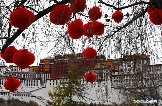 Decorations are hung from trees in front of the Potala Palace in Lhasa, capital of southwest China's Tibet Autonomous Region, Feb. 12, 2018, to greet the Spring Festival and Tibetan New Year. (Xinhua/Chogo)
