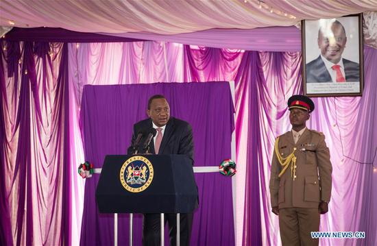 "Kenyan President Uhuru Kenyatta (L) delivers a speech during the launching ceremony of the ""Beyond Zero"" campaign in Nairobi, Kenya, March 8, 2018. Kenya's First Lady Margaret Kenyatta on Thursday launched a second strategic plan for her campaign dubbed ""Beyond Zero,"" and vowed to fight cancer and maternal and child mortality. (Xinhua/Lyu Shuai)"
