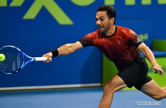 Victor Estrella Burgos of Dominican Republic hits a return during the first round match against Richard Gasquet of France at the ATP Qatar Open in Doha, Qatar, on Jan. 2, 2018. Richard Gasquet won 2-0. (Xinhua/Nikku)