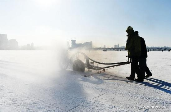 Workers cut ice from the Songhua River, marking the beginning of ice collecting season in Harbin, capital of northeast China's Heilongjiang Province, Dec. 3, 2017. For the coming month, workers will collect ice cube from the frozen Songhua River to prepare for the construction of the Ice and Snow World, where buildings of ice are illuminated by colorful lights. (Xinhua/Wang Jianwei)