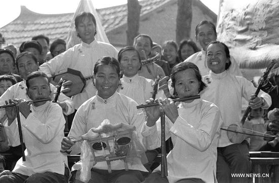 File photo taken in January 1986 shows women performing with instruments to greet the Spring Festival in Yunwei Village of Hanjiang District in Putian City, southeast China's Fujian Province. In Chinese villages, people have their distinctive ways to celebrate the Spring Festival. Simple but joyful, the celebrations bring them gratification and happiness. Spring festival, or better known as Chinese Lunar New year, is the most important festival for all Chinese, which has a history of more than 4,000 years. It is an occasion for home returning, New Year goods preparing, celebrating, and foremost, family reunion. (Xinhua/Gu Xinsheng)