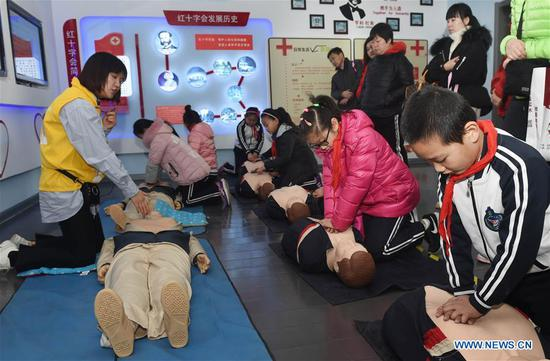 Children attend a lecture on first-aid at a home safety training center in Qingdao, east China's Shandong Province, March 7, 2018. The Qingdao Municipal Women's Federation organized a home safety workshop on Wednesday, allowing participants to learn home safety knowledge and skills via on-the-spot training sessions. (Xinhua/Li Ziheng)