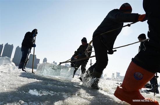Workers collect ice cube from the Songhua River, marking the beginning of ice collecting season in Harbin, capital of northeast China's Heilongjiang Province, Dec. 3, 2017. For the coming month, workers will collect ice cube from the frozen Songhua River to prepare for the construction of the Ice and Snow World, where buildings of ice are illuminated by colorful lights. (Xinhua/Wang Jianwei)