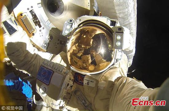 Two cosmonauts have completed the longest ever Russian spacewalk spending 8 hours and 13 minutes outside of their rocket to install a new communications antenna. Expedition 54 Commander Alexander Misurkin and Flight Engineer Anton Shkaplerov of the Russian space agency Roscosmos completed the spacewalk - making it the longest Russian spacewalk in history - breaking the previous record of 8 hours and 7 minutes. Stunning pictures show the two cosmonauts working methodically to install the antenna with the blue hue of planet earth illuminating their expedition. (Photo/VCG)