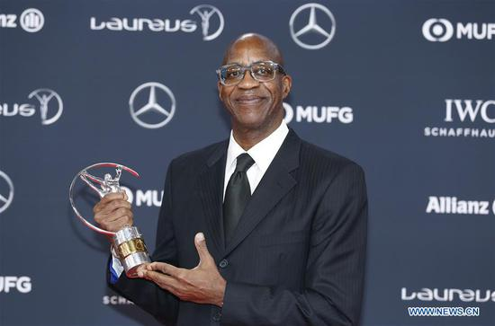 Former track and field athlete Edwin Moses of the United States poses with the