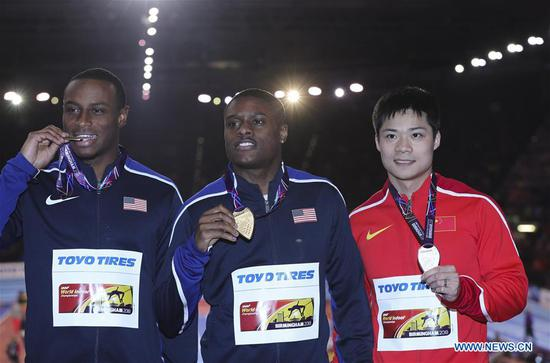 (L to R) Bronze medalist Ronnie Baker of the United States, gold medalist Christian Coleman of the United States, silver medalist Su Bingtian of China pose during the medal ceremony for the men's 60m of the IAAF World Indoor Championships at Arena Birmingham in Birmingham, Britain on March 4, 2018. (Xinhua/Han Yan)