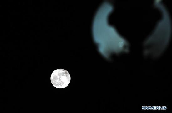 The supermoon is seen in Rawalpindi, Pakistan, on Dec. 3, 2017. (Xinhua/Ahmad Kamal)