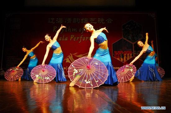Chinese artists perform during the Rhythm of Liaohai Gala Performance in Islamabad, capital of Pakistan on Dec. 7, 2017. (Xinhua/Saadia Seher)
