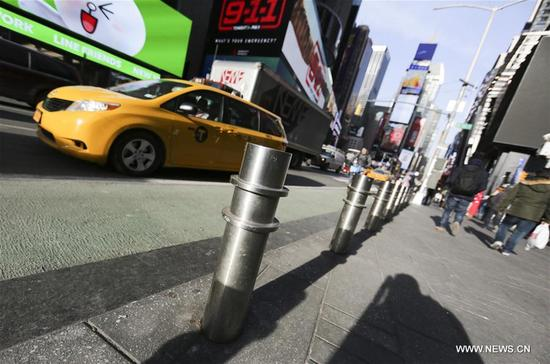 Metal bollards are seen placed at Times Square in New York, the United States, on Jan. 3, 2018. New York City plans to install 1,500 new security barriers in high-profile locations to guard against vehicle attacks and other terror-related incidents. (Xinhua/Wang Ying)