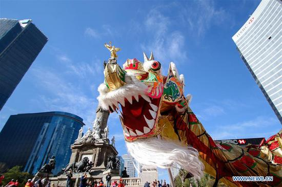 Dancers perform a Dragon Dance during a costume contest to celebrate the upcoming Chinese New Year, in Mexico City, capital of Mexico, on Feb. 11, 2018. (Xinhua/Francisco Canedo)