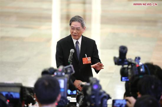 Zhang Zhijun, director of the Taiwan Affairs Office of the State Council, receives an interview after the opening meeting of the first session of the 13th National People's Congress at the Great Hall of the People in Beijing, capital of China, March 5, 2018. (Xinhua/Jin Liwang)