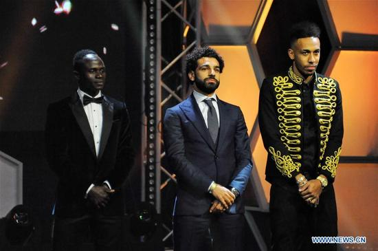 Mohamed Salah (C) of Egypt, Sadio Mane (L) of Senegal and Pierre-Emerick Aubameyang of Gabon attend the Confederation of African Football awards ceremony in Accra, Ghana, Jan. 4, 2018. Salah received the African Player of the Year award. (Xinhua/Shi Song)