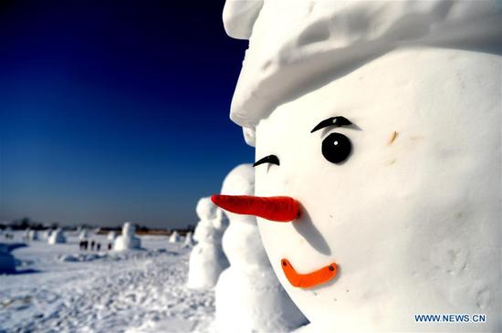 Snowman sculptures are seen at an ice and snow park in Harbin, capital of northeast China's Heilongjiang Province, Jan. 11, 2018. Altogether 2,018 cute snowmen were displayed here to greet the year 2018. (Xinhua/Wang Kai)
