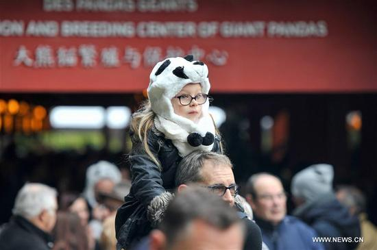 "A girl in a panda hat visits the Zooparc de Beauval in Saint-Aignan, France on Jan. 13, 2018. The first panda cub born in France ""Yuan Meng"" debuts with the public on Saturday morning. (Xinhua/Chen Yichen)"
