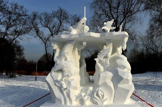 The work from Team Malaysia, Survivor, wins the second prize at the 23rd Harbin International Snow Sculpture Competition in Harbin, capital of northeast China's Heilongjiang Province, Jan. 13, 2018. The four-day competition concluded here on Saturday, with a total of 25 teams from home and abroad participating in the game. (Xinhua/Wang Jianwei)