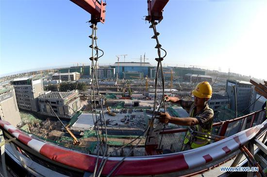 Photo taken on Sept. 11, 2017 shows a construction site of the capital's subsidiary administrative center in Beijing, capital of China. China's annual political sessions of the National People's Congress (NPC) and the National Committee of the Chinese People's Political Consultative Conference (CPPCC) are scheduled to convene in March, 2018. During the two sessions, development agendas will be reviewed and discussed, and key policies will be adopted. According to the 13th five-year plan for economic and social development of China covering the period 2016 to 2020, coordination has been emphasized as an integral quality of sustained and healthy development, which underlines advancing coordinated development between rural and urban areas, between different regions, and between economic and social development. (Xinhua/Luo Xiaoguang)