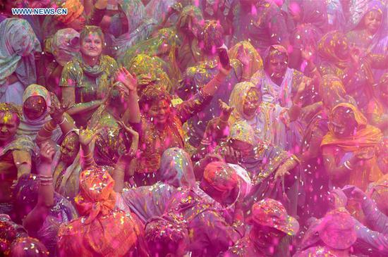 Indian widows celebrate the Holi festival with others at Vrindavan, India, on Feb. 27, 2018.(Xinhua/Partha Sarkar)