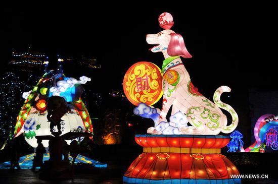 Tourists visit a lantern fair to greet the upcoming Lantern Festival in Nanning, capital of south China's Guangxi Zhuang Autonomous Region, Feb. 27, 2018. The Lantern Festival falls on the 15th day of the first lunar month, or March 2 this year. (Xinhua/Zhao Jingwu)