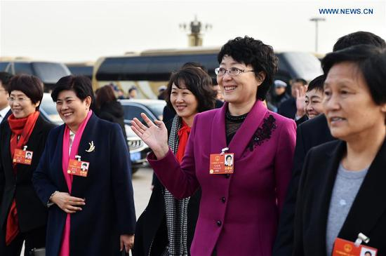 Deputies to the 13th National People's Congress (NPC) walk to the Great Hall of the People for the opening meeting of the first session of the 13th NPC in Beijing, capital of China, March 5, 2018. (Xinhua/Li Ran)