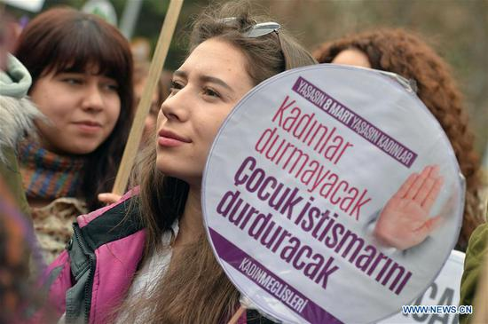 A woman holds a banner during a rally to celebrate International Women's Day in Ankara, Turkey, on March 8, 2018. International Women's Day was celebrated across Turkey on Thursday through events including marches and workshops. (Xinhua/Mustafa Kaya)