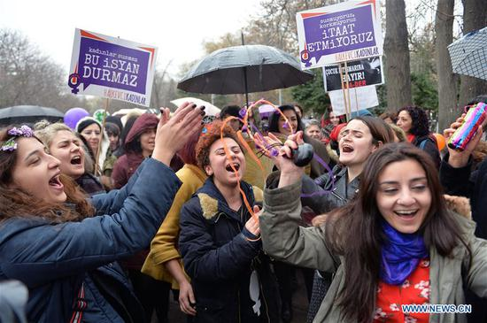 Women sing during a rally to celebrate International Women's Day in Ankara, Turkey, on March 8, 2018. International Women's Day was celebrated across Turkey on Thursday through events including marches and workshops. (Xinhua/Mustafa Kaya)