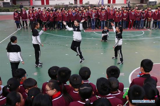 Students of a primary school perform fancy rope skipping in Huaibei, east China's Anhui Province, Nov. 28, 2017. Fancy rope skipping gained popularity among students here for its combination of dancing, gymnastics and dynamic music. (Xinhua/Wan Shanchao)