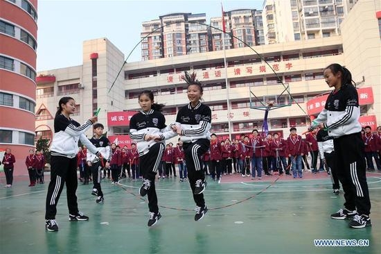 Students of a primary school perform fancy rope skipping in Huaibei, east China's Anhui Province, Nov. 28, 2017. Fancy rope skipping gained popularity among students here for its combination of dancing, gymnastics and dynamic music.(Xinhua/Wan Shanchao)