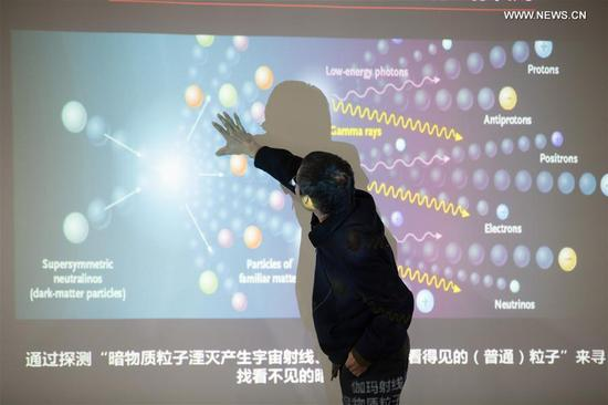 Photo taken on Nov. 2, 2017 shows Fan Yizhong, deputy chief designer of the scientific application system of the Dark Matter Particle Explorer (DAMPE), introduces research findings at the Purple Mountain Observatory of the Chinese Academy of Sciences (CAS) in Nanjing, capital of east China's Jiangsu Province.