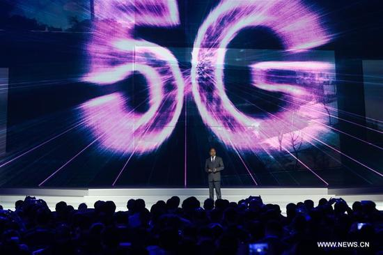 Xu Zhijun, Huawei's rotating CEO, introduces achievements of 5G technology during the release ceremony for world leading Internet scientific and technological achievements in Wuzhen, east China's Zhejiang Province, Dec. 3, 2017. The Fourth World Internet Conference opened in Wuzhen on Sunday. (Xinhua/Zheng Huansong)