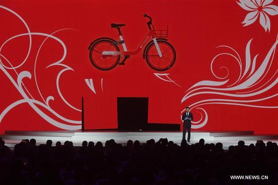 Mobike CEO Wang Xiaofeng speaks during the release ceremony for world leading Internet scientific and technological achievements in Wuzhen, east China's Zhejiang Province, Dec. 3, 2017. The Fourth World Internet Conference opened in Wuzhen on Sunday. (Xinhua/Huang Zongzhi)