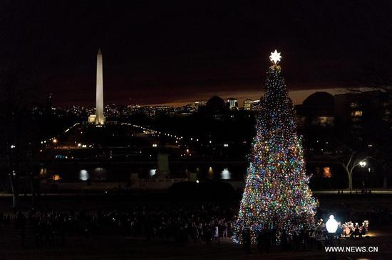 The Capitol Christmas Tree is lit on the west front lawn of the U.S. Capitol in Washington Dec. 6, 2017. The Capitol Christmas Tree has been a tradition since 1964. (Xinhua/Shen Ting)