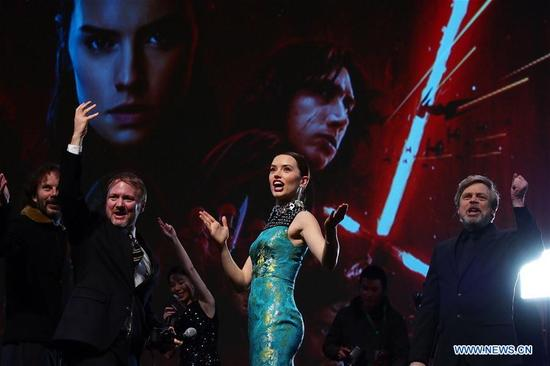 "Israeli producer Ram Bergman, U.S. director Rian Johnson, British actress Daisy Ridley, U.S. actor Mark Hamill (L-R) pose for pictures at the Chinese premiere of ""Star Wars: The Last Jedi"" at the Shanghai Disney Resort in east China's Shanghai, Dec. 20, 2017. The film will be screened in China on Jan. 5, 2018. (Xinhua/Ren Long)"