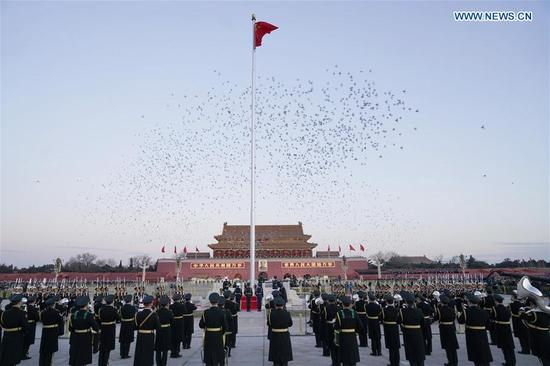 The Guard of Honor of the Chinese People's Liberation Army (PLA) perform the national flag-raising duty at the Tian'anmen Square in Beijing, capital of China, Jan. 1, 2018. The responsibility for guarding China's national flag and firing salute cannons at the Tian'anmen Square was transferred to the Chinese People's Liberation Army from Jan. 1, 2018, as authorized by the Central Committee of the Communist Party of China. Before Jan. 1, the ceremony was conducted by the armed police. (Xinhua/Xing Guangli)