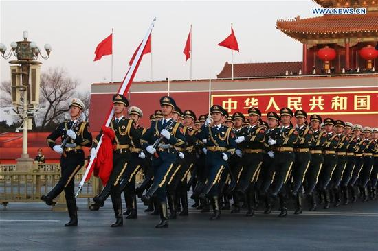 The Guard of Honor of the Chinese People's Liberation Army (PLA) perform the national flag-raising duty at the Tian'anmen Square in Beijing, capital of China, Jan. 1, 2018. The responsibility for guarding China's national flag and firing salute cannons at the Tian'anmen Square was transferred to the Chinese People's Liberation Army from Jan. 1, 2018, as authorized by the Central Committee of the Communist Party of China. Before Jan. 1, the ceremony was conducted by the armed police. (Xinhua/Ju Zhenhua)