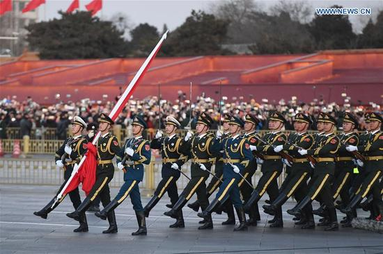 The Guard of Honor of the Chinese People's Liberation Army (PLA) perform the national flag-raising duty at the Tian'anmen Square in Beijing, capital of China, Jan. 1, 2018. The responsibility for guarding China's national flag and firing salute cannons at the Tian'anmen Square was transferred to the Chinese People's Liberation Army from Jan. 1, 2018, as authorized by the Central Committee of the Communist Party of China. Before Jan. 1, the ceremony was conducted by the armed police. (Xinhua/Shen Hong)