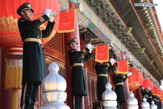 Buglers perform at the national flag-raising ceremony at the Tian'anmen Square in Beijing, capital of China, Jan. 1, 2018. The responsibility for guarding China's national flag and firing salute cannons at the Tian'anmen Square was transferred to the Chinese People's Liberation Army from Jan. 1, 2018, as authorized by the Central Committee of the Communist Party of China. Before Jan. 1, the ceremony was conducted by the armed police. (Xinhua/Li Gang)