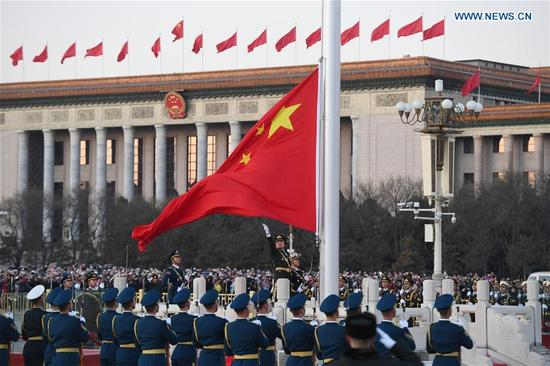The Guard of Honor of the Chinese People's Liberation Army(PLA) perform the national flag-raising duty at the Tian'anmen Square in Beijing, capital of China, Jan. 1, 2018. The responsibility for guarding China's national flag and firing salute cannons at the Tian'anmen Square was transferred to the Chinese People's Liberation Army from Jan. 1, 2018, as authorized by the Central Committee of the Communist Party of China. Before Jan. 1, the ceremony was conducted by the armed police. (Xinhua/Shen Hong)