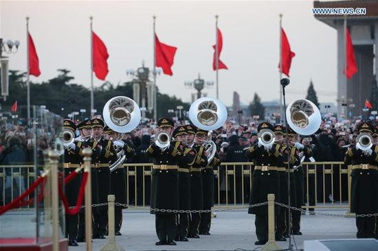 The military band of the Chinese People's Liberation Army (PLA) perform in the national flag-raising ceremony at the Tian'anmen Square in Beijing, capital of China, Jan. 1, 2018. The responsibility for guarding China's national flag and firing salute cannons at the Tian'anmen Square was transferred to the Chinese People's Liberation Army from Jan. 1, 2018, as authorized by the Central Committee of the Communist Party of China. Before Jan. 1, the ceremony was conducted by the armed police. (Xinhua/Ju Zhenhua)