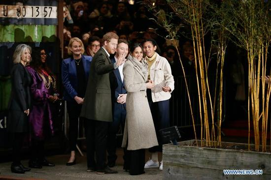 Prince Harry (4th R) and Meghan Markle (2nd R) arrive for a visit to Reprezent Radio at Pop Brixton in London, Britain, on Jan. 9, 2018. Prince Harry and Meghan Markle are to marry in a ceremony at Windsor castle on May 19. (Xinhua/Tim Ireland)