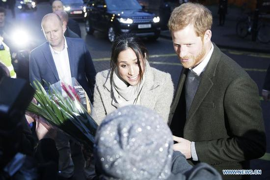 Prince Harry (R) and Meghan Markle (C) leave after a visit to Reprezent Radio at Pop Brixton in London, Britain, on Jan. 9, 2018. Prince Harry and Meghan Markle are to marry in a ceremony at Windsor castle on May 19. (Xinhua/Tim Ireland)