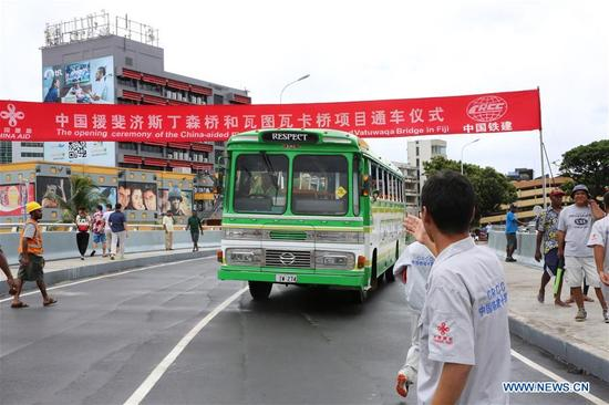 A bus goes through the Stinson Parade Bridge during the opening ceremony of the China-aided projects for Stinson Parade Bridge and Vatuwaqa Bridge, in Suva, Fiji, on Jan. 11, 2018. Two China-aided bridges in the Fijian capital city were open to traffic Thursday following the hard work by hundreds of workers from both countries. (Xinhua/Zhang Yongxing)