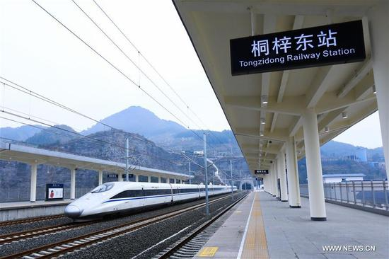 A bullet trains passes by Tongzi East Railway Station in southwest China's Chongqing Municipality, Jan. 11, 2018. A railway connecting two major cities in southwest China, Chongqing and Guiyang is under trial run. Designed for passenger trains running at a speed of 200 kilometers per hour, the railway will improve traffic between China's southwest and northwestern, eastern, southern areas. (Xinhua/Han Ye)