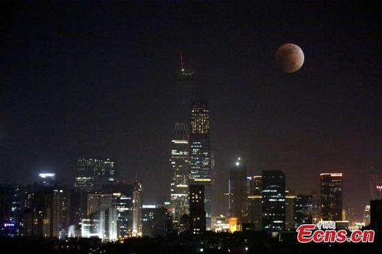 The super blue moon rises over Central Business District in Beijing, China, Jan. 31, 2018. (Photo: China News Service/Li Huisi)