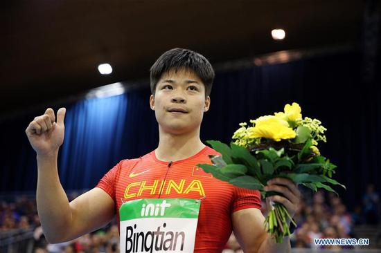 Su Bingtian of China celebrates after winning Men's 60m final of the 2018 IAAF World Indoor Tour in Karlsruhe, Germany, on Feb. 3, 2018. Su Bingtian claimed the title with 6.47 seconds.(Xinhua/Luo Huanhuan)